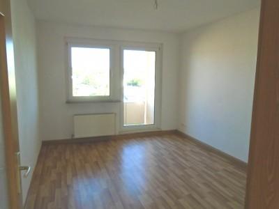 Beispielfoto Wohnzimmer mit Balkon